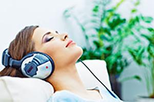 Young woman home portrait. Sleeping girl with headphones. Music.